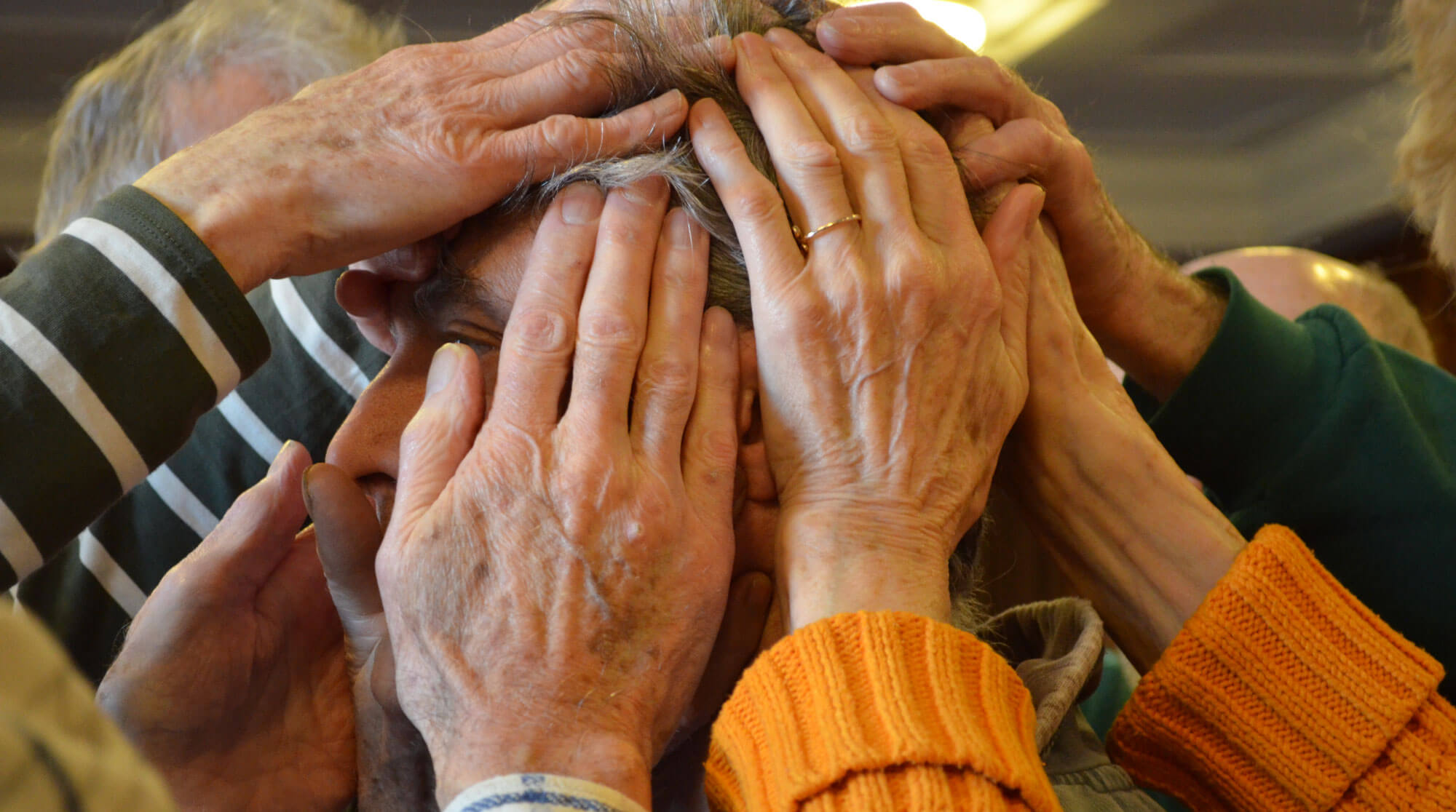 Hands covering a head for Eldership in the 21st Century